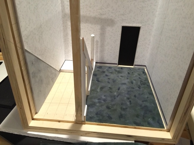 Carpeting installed and beginnings of staircase and outer wall of the cupboard.